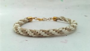 beige and pale gold striped Kumihimo braided cord bracelet
