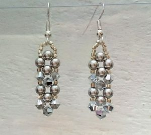 Earrings made using crystal bicones and glass pearls