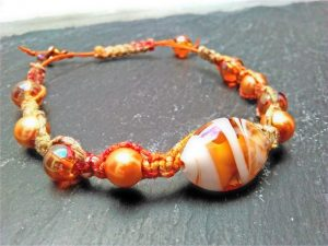 Macrame bracelet using orange coloured glass beads