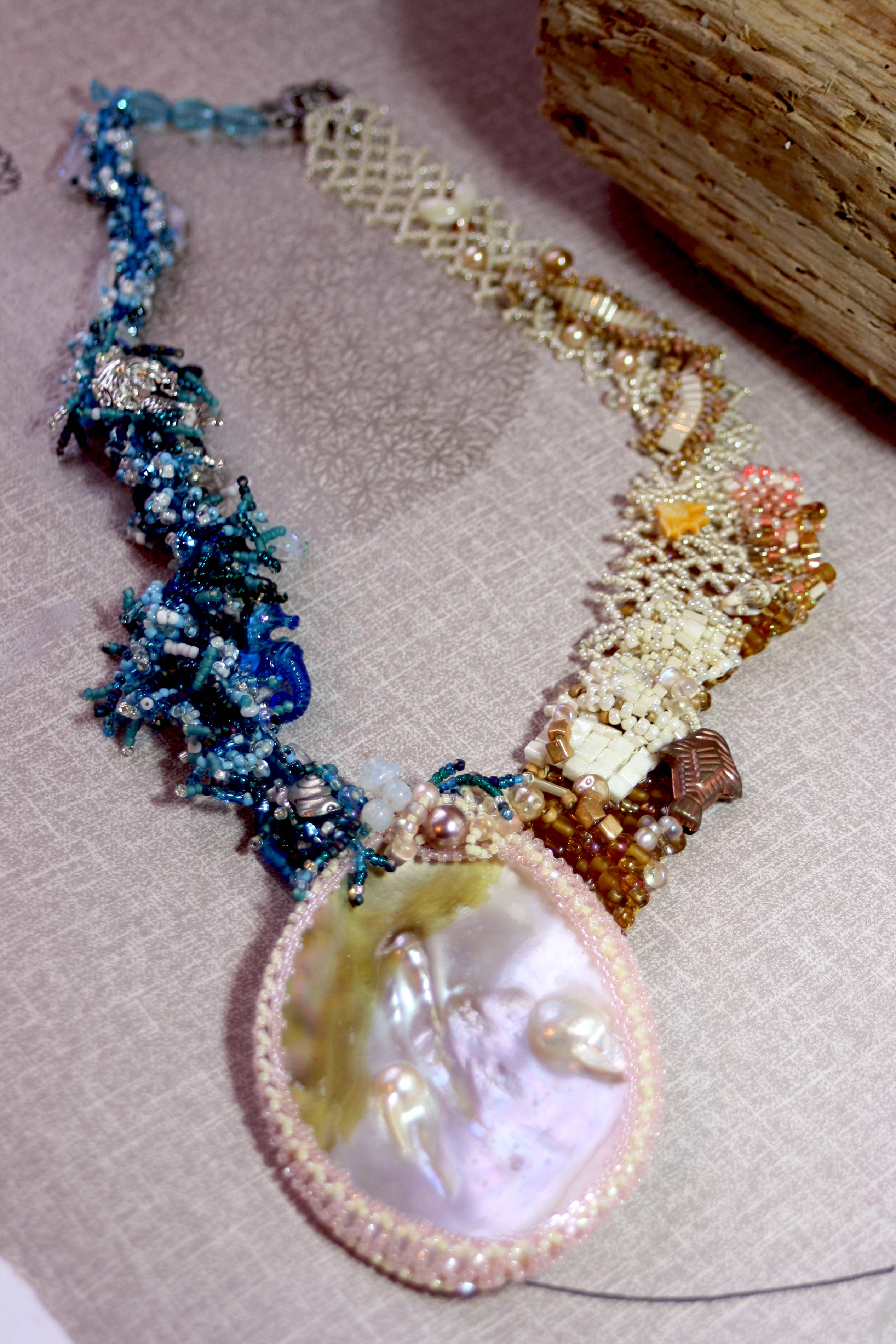 large pearl focal pendant with cream and blue seed bead necklace strap