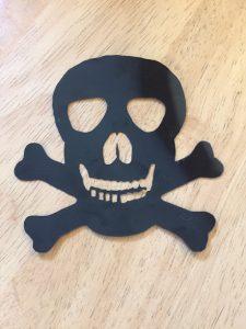 black shrink plastic skull pendant